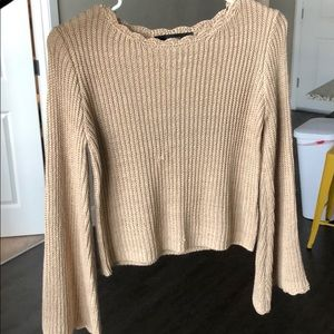 Nude knit sweater with wide sleeves
